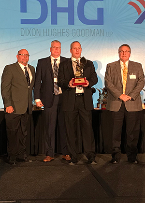 Everette Lewis, production manager; David Farmer, senior operations manager; Bill Brittelli, regional vice president; and Bill Robinson, vice president of marketing, accepting the Eagle Award for Watson Electrical Construction.
