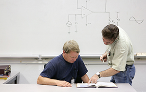 Instructor and student in a classroom